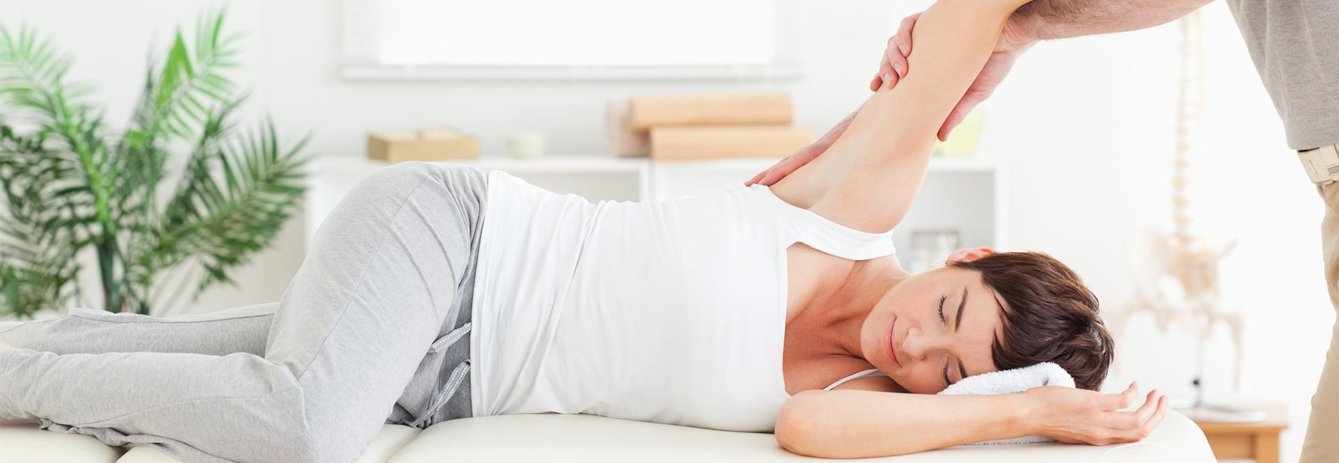 woman getting adjusted by a chiropractor